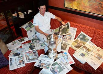Justin Rose reads newspaper accounts of his U.S. Open win Monday morning. Rose is playing this week at the Travelers Championship in Cromwell, Conn.
