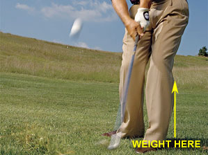 Lash the ball out of deep rough by keeping most of your weight on your left side.