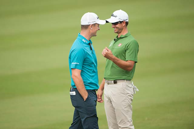 2013 major winners and good friends Adam Scott and Justin Rose enjoy the fruits of their labor at the PGA Grand Slam of Golf in Bermuda.
