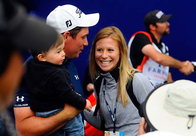 Scott Stallings celebrates his win at the Farmers Insurance Open on Sunday with his wife, Jennifer, and his son, Finn.