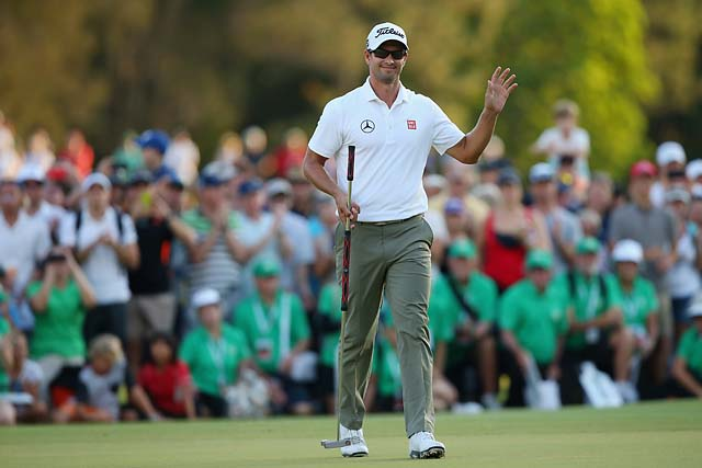 Adam Scott waves to the crowd on the 18th hole of the Australian PGA on Sunday. Many in the crowd wore green in honor of Scott's Masters win in April.