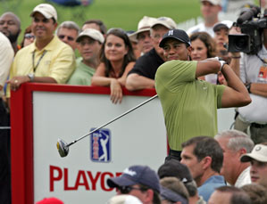Tiger Woods leads the Tour Championship, and the race for the FedEx Cup.