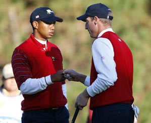 Tiger Woods and Jim Furyk beat Ernie Els and Adam Scott 4 and 3.