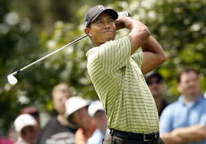 Tiger Woods made five birdies and one bogey to finish one behind the leaders.