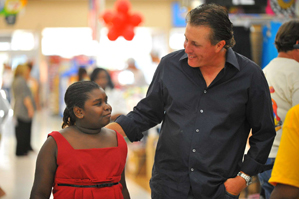 Phil and Amy Mickelson hosted 1,500 needy children for a back-to-school shopping spree at Wal-Mart.