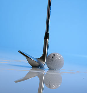 Don't pound your wedge into the sand — skip it across like you would a flat rock on a pond.
