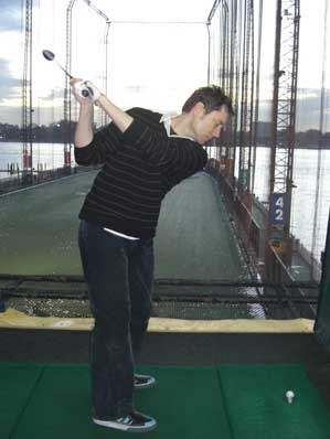 Christopher practicing at Chelsea Piers Golf Club.
