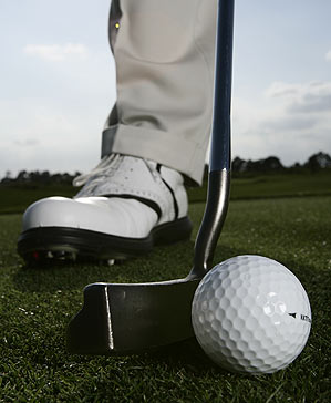 Hover your putter at address. You'll encourage a smoother start to your stroke and hit putts that roll with correct speed.
