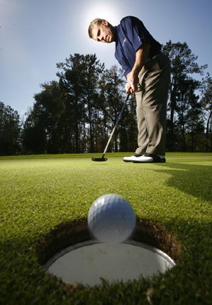 Proper hand position will help you drain more putts.