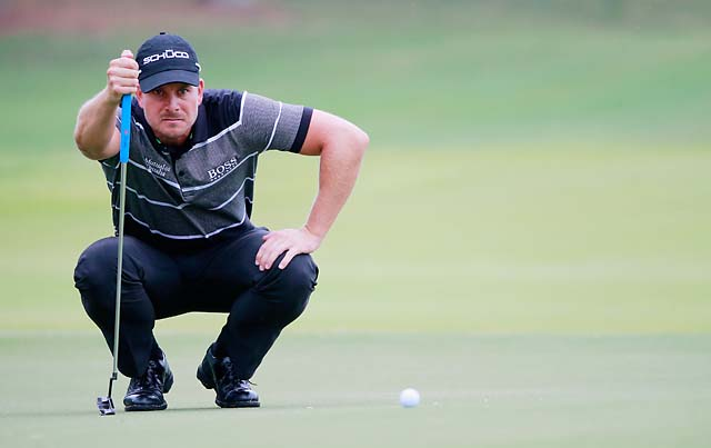 Henrik Stenson lines up a putt on the fourth green during the third round of the Tour Championship on Saturday.