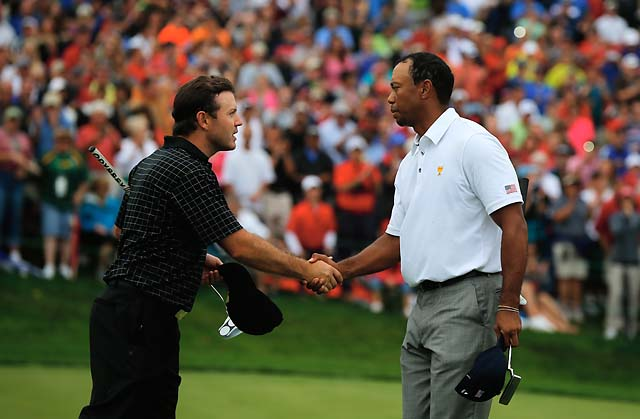 Tiger Woods and Richard Sterne shake hands after Woods defeated Sterne 1-up in Sunday singles. The victory clinched the Presidents Cup for the Americans.