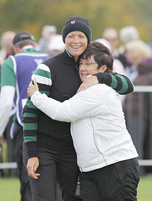 Suzann Pettersen, left, hugs captain Alison Nicholas, after Pettersen won her foursomes match.