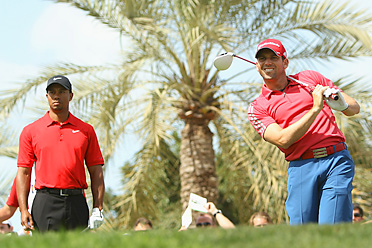 Tiger Woods and Sergio Garcia shot matching 75s in the final round of the Dubai Desert Classic.