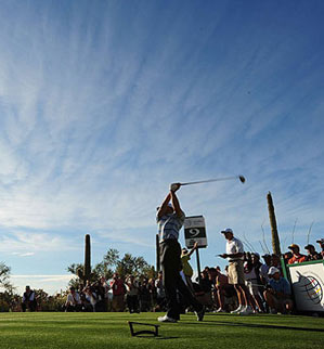 Surrounded by media and fans, Tiger Woods played a practice round Tuesday morning.
