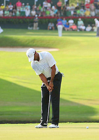 Tiger Woods opened with a 66 to tie Justin Rose for the lead.