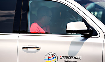 Tiger Woods leaves Firestone Country Club after withdrawing from the WGC-Bridgestone with a back injury.