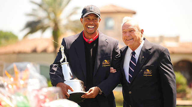 Tiger Woods shares a laugh with Arnold Palmer after winning for the eighth time at Bay Hill.