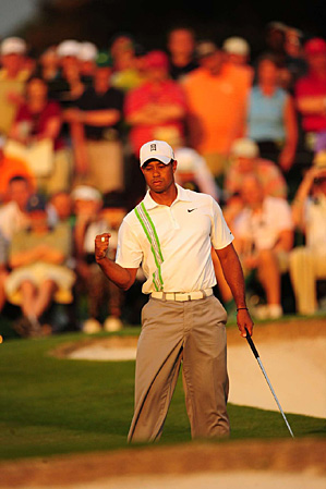 Woods birdied the 18th Friday to move into a tie for third.