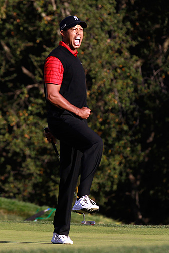Woods struck a familiar pose after Sunday's victory.