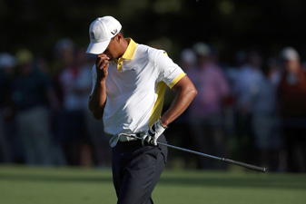 Tiger Woods was penalized two shots for taking an improper drop at the Masters.