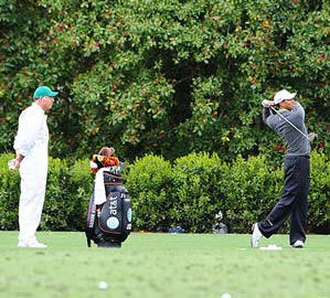 Tiger Woods hit a few balls with caddie Steve Williams looking on.