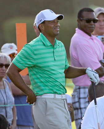 Tiger Woods was all smiles for most of his Wednesday practice round, but he did strain his lower back on the sixth tee.