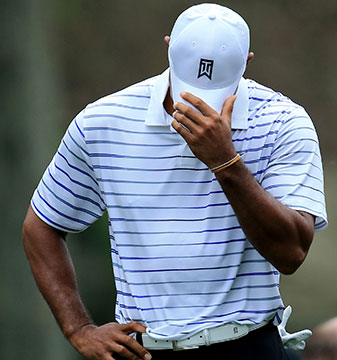 Tiger Woods reacts to a shot on the 15th hole at the PGA Championship on Friday.