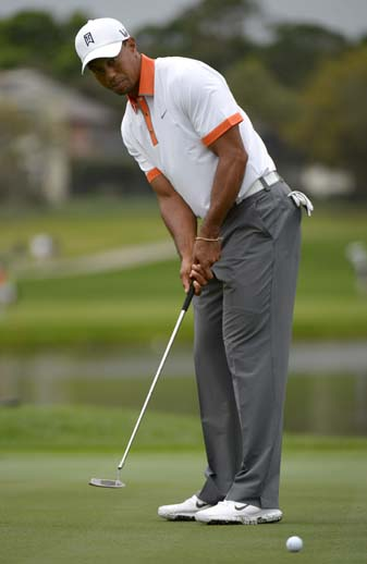 Tiger Woods putts at the Arnold Palmer Invitational, where he won his third event of the 2013 season, and he is the favorite at this year's Masters Tournament.