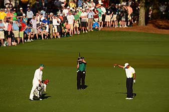 Tiger Woods makes his infamous drop at the 15th hole Friday at the 2013 Masters.