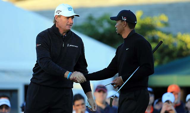 Ernie Els and Tiger Woods at the Arnold Palmer Invitational in March 2013. Els has withdrawn from Woods' December tournament.