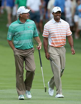 U.S. Presidents Cup captain Fred Couples and Tiger Woods at the Memorial in June 2013.