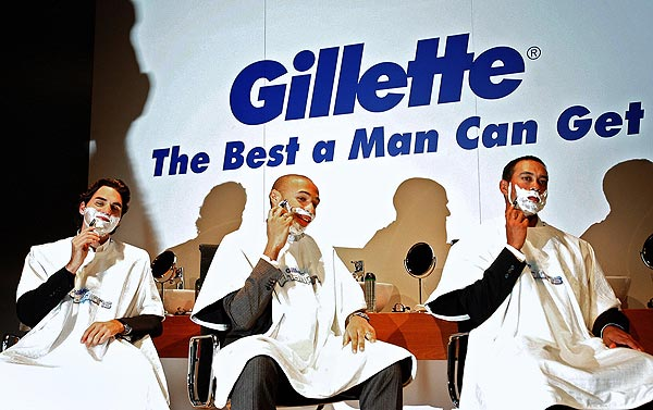 "Tiger Woods with Roger Federer, left, and Thierry Henry. All three were part of the Gillette's ""Champions"" campaign."