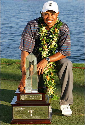 That's right. Even weight-lifting Tiger Woods is kneeling next to the huge winner's trophy.