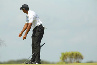 Tiger Woods made three bogeys in four holes before play was suspended.