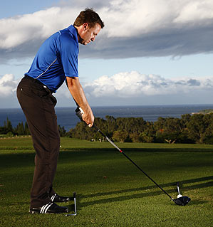 <strong>PRACTICE TIP</strong> Lay a club against your toes and another on your target line to get a feel for how much you should open your body to the target. If you want a 10-yard fade, the club against your toes should point 10 yards left of target.