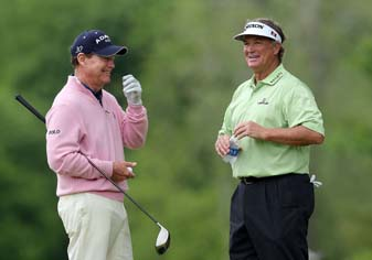 Tom Watson shares a laugh with Peter Jacobsen on the fifth hole during the Senior PGA Championship