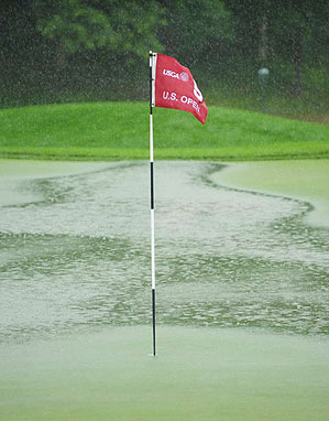 Greens and fairways at Bethpage Black were flooded from the rain.
