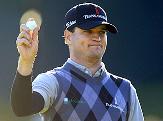 Zach Johnson eagled the par-4 18th to grab the lead.