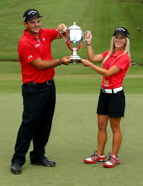 Patrick Reed and his wife Justine celebrate after defeating Jordan Spieth on the second hole of a playoff during the final round of the Wyndham Championship
