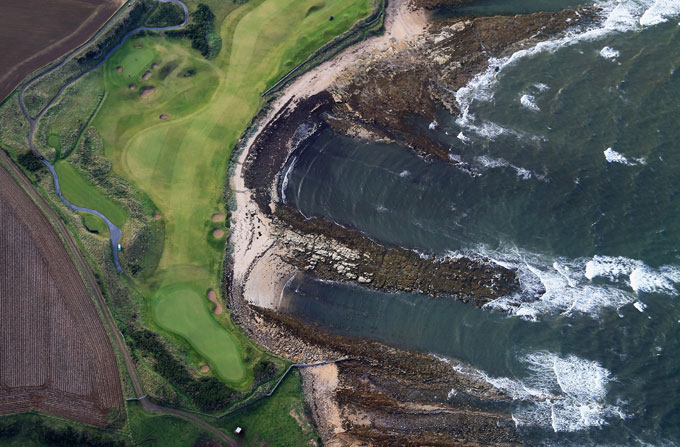 Kingsbarns                       An aerial view of the par 5, 12th hole along the beach and the par 3, 13th hole on the course at Kingsbarns during practice for the 2013 Alfred Dunhill Links Championship on September 25, 2013 in Kingsbarns, Scotland.