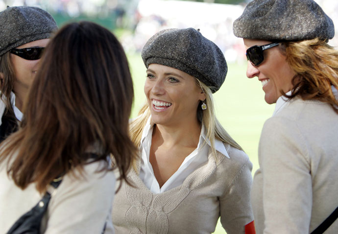 Wives of United States team members Amy DiMarco, right and Amy Mickelson, center, chat with other wives at the 2006 Ryder Cup.