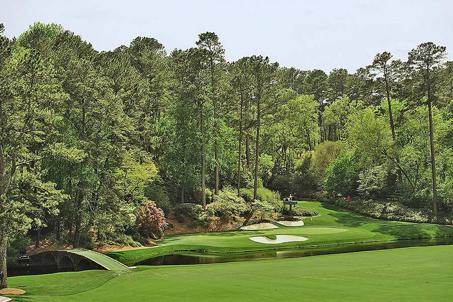 "Tee shot at the 155-yard, par-3 12th at Augusta National Golf Club -- Augusta, Ga.Here, on the sharp edges of Amen Corner, where the wind is hard to figure and the tiny green is skewed at a tricky angle, a short iron over water sends terror into the hearts of even the game's top players. Asked if he ever feels comfortable on the tee, Tiger Woods said sure. ""On Monday, Tuesday and Wednesday."""