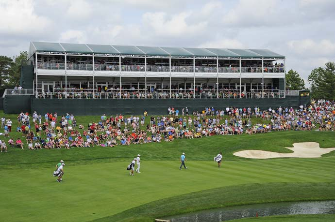 Fans surround the 14th green Sunday at Muirfield Village.