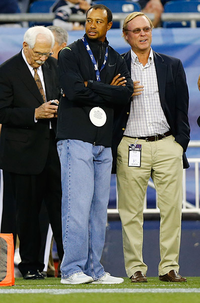 On the sidelines at a 2013 New England Patriots game, Tiger's baggy jeans are front and center.
