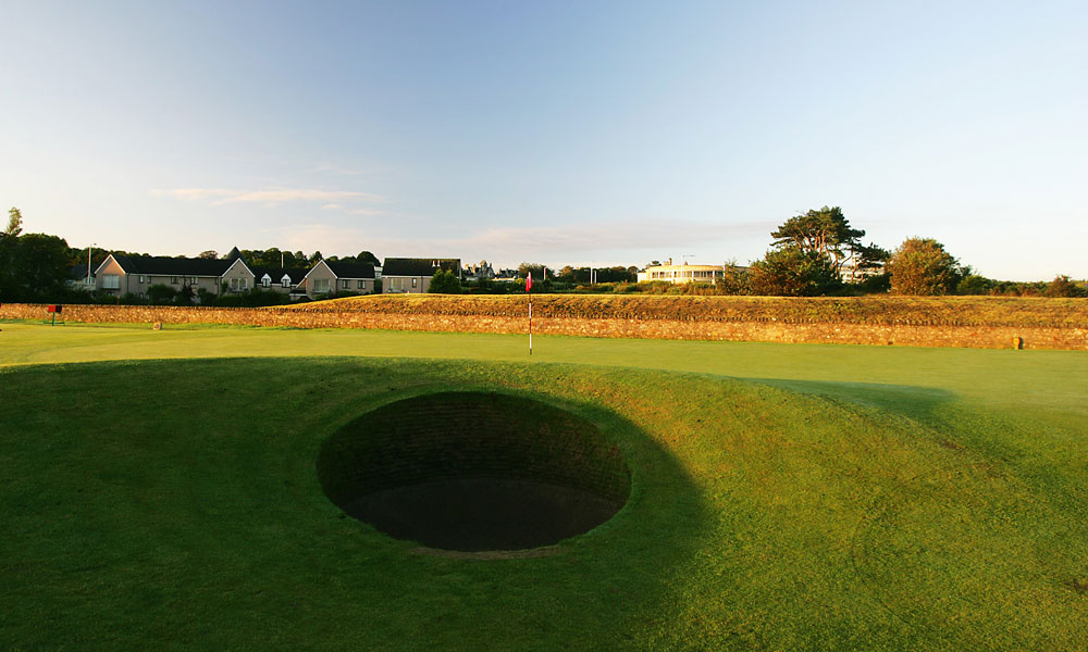 6. 17th at the Old Course at St. Andrews -- Par 4, 495 yards -- St. Andrews, Scotland                       At the 1978 British Open, Tommy Nakajima took five shots to escape it. In 2000, David Duval took four. But no one has kept tabs on the number of victims claimed by the infamous Road Hole Bunker, the most feared of the hazards on a hole that also features a slender fairway filled with humps and hillocks, ideally reached by taking your drive over a portion of the Old Course Hotel.