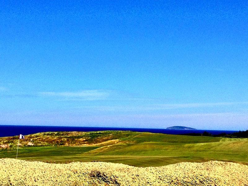 """@eamonlynch: Looking back down the 18th fairway toward Cabot's version of Ailsa Craig. A hell of a carry."""