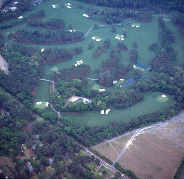 1997: Not every assignment works out as planned. Walter Bingham, a longtime golf editor at SI who, in retirement, would frequent our offices, liked to make the argument that the 3rd, 4th and 5th holes at Augusta National were every bit as demanding as the feared three-hole stretch of the 10th, 11th and 12th. Back in those days the front nine was seldom seen on television. The assignment went to Rusty Jarrett, a local shooter who at one time was Augusta National's official photographer. Unfortunately, they were thwarted by a stretch of bad weather and this was the best Rusty could do. They decided to go with an illustration instead of a photograph. The par-4 3rd hole is shown at the top of what appears to be a horseshoe, followed by the par-3 4th and the par-4 5th.