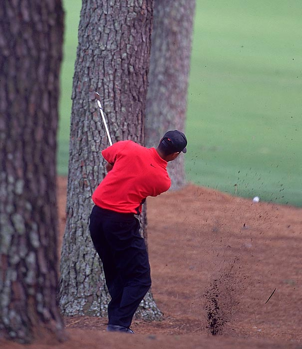 Woods hit a shot off the pine straw on his way to victory in 1997.