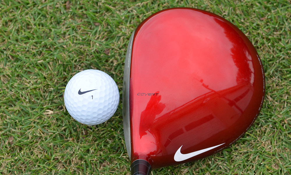 "At address, the Nike VR_S Covert Performance driver features a red crown and a single white swoosh. The word ""Covert"" acts as the alignment aid."
