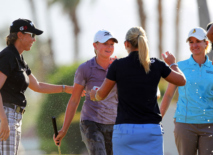 Her fellow competitors gave Stacy Lewis a celebratory beer shower after she captured her first LPGA victory -- and first major -- at the 2011 Kraft Nabisco Championship. Lewis finished three strokes ahead of Yani Tseng.